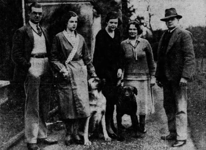 Group photo showing Lightoller with his wife, children and two dogs