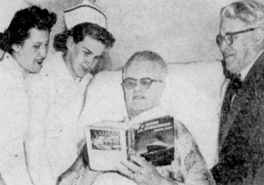 William Loch Coutts reading from his hospital bed